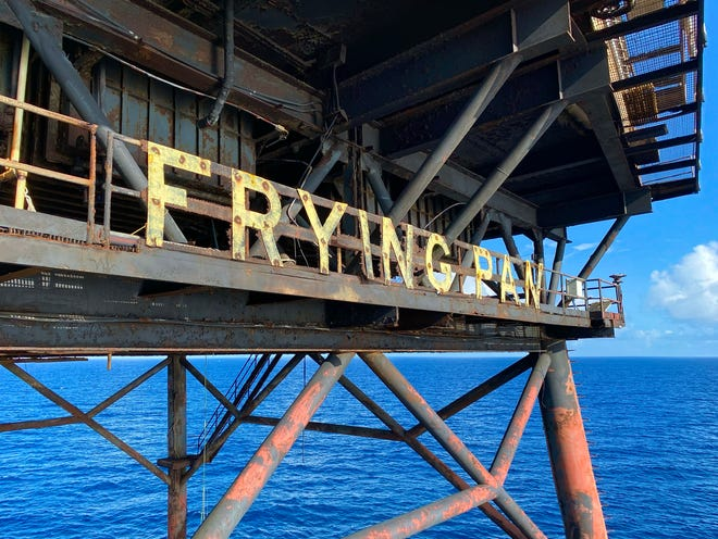 The rusting signage on Frying Pan Tower, a light station built by the U.S. Coast Guard in 1964, as seen from the west side of the tower, which sits 32 miles off the coast. [HUNTER INGRAM/STARNEWS]