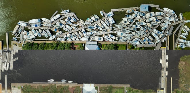Aerial drone shots of the Southport Marina on Aug. 4 (top), the day after Hurricane Isaias, and on Aug. 26 (bottom), after all of the boats had been removed from the basin in Southport. [PHOTOS COURTESY OF SOUTHPORT MARINA]