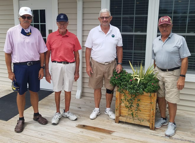 First place winners in the MGA Red Tee Wipe Out event were (left to right) David Ross, C.A. Smith, Charlie Henke, and Jim Furman. [CONTRIBUTED PHOTO]