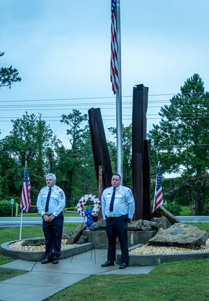 Tri-County Volunteer Fire Department Chief Jarrod Davis and Assistant Chief Jimmy Hart laid the Memorial Wreath at the site of the 9-11 Memorial in Fairfield Harbour during the community's commemorative ceremony. [Photo courtesy of Pat Dumon]