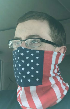 Seth Toler sports his mask. He plans on attending a rally President Donald Trump has scheduled for Saturday at the Fayetteville Regional Airport.