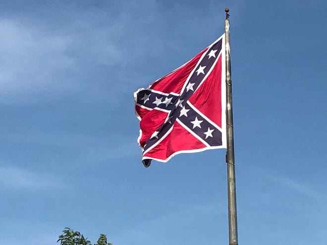 A Confederate flag was replaced Tuesday at its location off southbound Interstate 95, north of Fayetteville in Cumberland County.