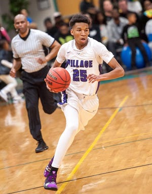 Justin Thomas (25), who helped Village Christian earn a conference title and second consecutive appearance in the NCISAA 3-A state championship, will be playing college basketball at Queens University of Charlotte