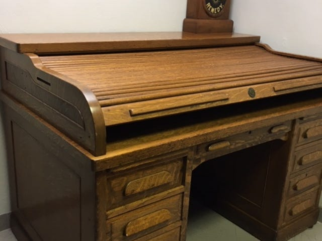 The oak roll top desk was likely made in Grand Rapids, Mich., between 1900 and 1930.