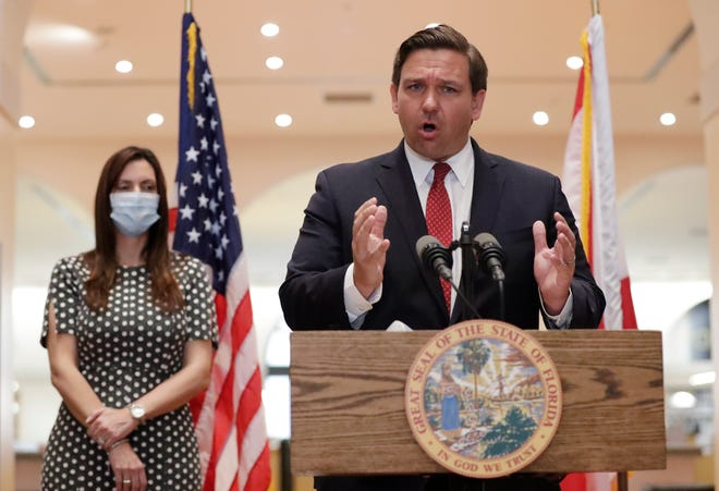 Florida Gov. Ron DeSantis gestures as he speaks during a news conference along side Lt. Gov. Jeanette Nunez on May 26 as he announced his appointments to the state Supreme Court.