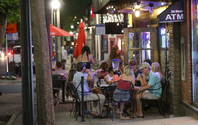 Tuscaloosa city officials are preparing to launch a program to allow restaurants, like Glory Bound Gyro Co. on The Strip, additional seating capacity in public rights-of-way. [Staff file photo/Gary Cosby Jr.]