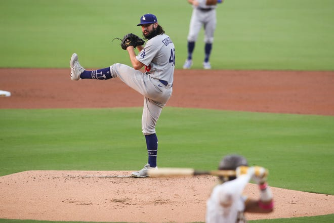 Dodgers starting pitcher Tony Gonsolin pitches to San Diego Padres' Fernando Tatis Jr., in the first inning Tuesday, Sept. 15, 2020, in San Diego.
