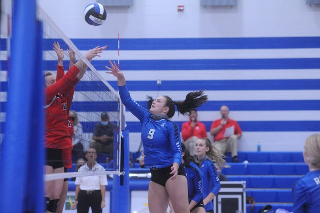 Wynford's Adrienne Whitmeyer tips a ball over Mohawk's Paityn Clouse.
