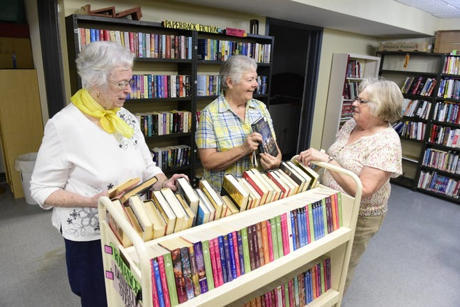 From left, Maureen Sharrock, Cidy Eusey and Sarah Gebhardt prepare for this weekend's Friends of the Bucyrus Public Library book sale.
