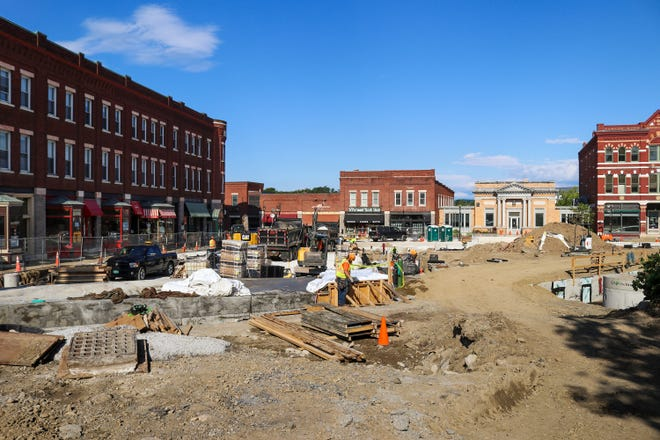 Looking down Merchant's Row toward Main Street, construction crews can be seen working on the Middlebury rail tunnel project in late August.