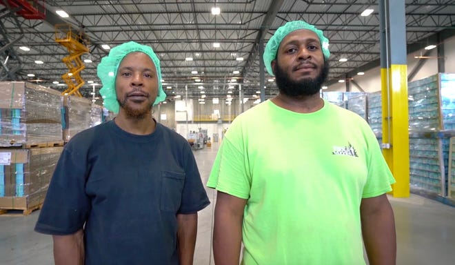 Vernon White (left) and Brooks Walker work at Action Pak in Camden. The two men, part of a re-entry program for people who were formerly incarcerated, found employment through Camden Works and Volunteers of America.