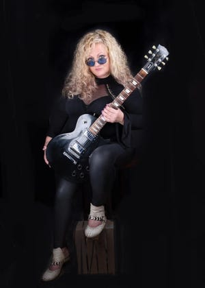 Renee Hose is the singer/guitarist/keyboardist for local rock cover band Relentless Fire. She recently released a solo album.
