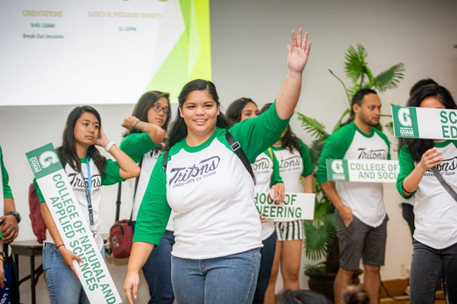 University of Guam student Kateri Santos helps welcome new students to campus at an orientation event in January in this photo provides by the university.