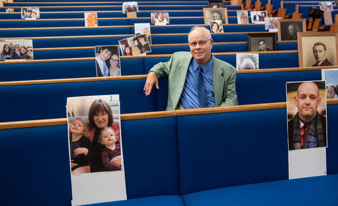 Rabbi David Ariel-Joel sits among photos of his congregation at The Temple. This year's Rosh Hashannah celebration will be virtual and live streamed due to the coronavius. Sept. 16, 2020