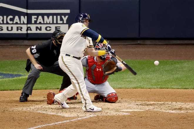 Daniel Vogelbach cracks his first homer as a Brewer in the seventh inning against the Cardinals.