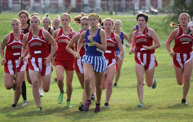 Mountain Home's Marcie Cudworth leads a pack of West Plains runners on Tuesday.