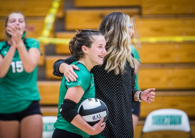 Yorktown's Ellee Stinson celebrates 1,000 digs during her team's game against New Castle at Yorktown High School Tuesday, Sept. 15, 2020.