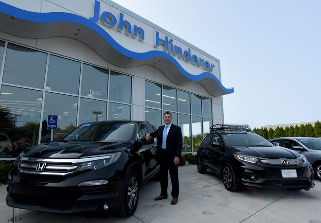 Justin Hinderer, chief operating officer at John Hinderer Honda, didn't always plan on joining the family business that has been a mainstay in Licking County.