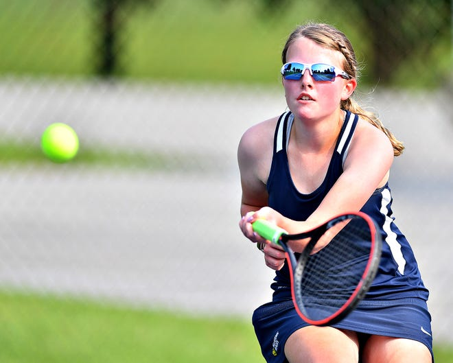 Dallastown's Hannah Sult returns the ball to Spring Grove's Maddie Groomes during girls' tennis action at Dallastown Area High School in York Township, Wednesday, Sept. 16, 2020. Dawn J. Sagert photo