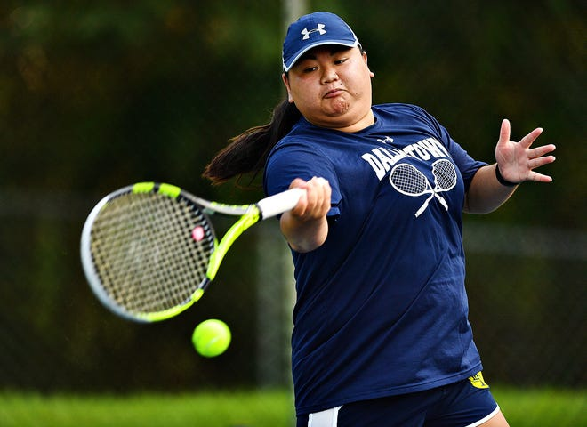 Dallastown's Grace Heird returns the ball to Spring Grove's Sara Diehl during girls' tennis action at Dallastown Area High School in York Township, Wednesday, Sept. 16, 2020. Dawn J. Sagert photo