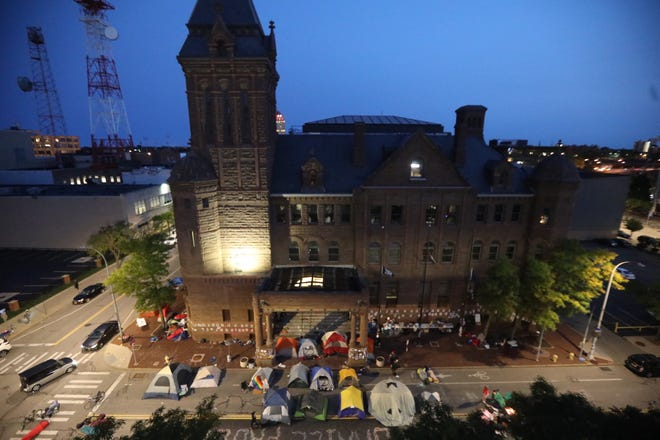 A look at Rochester's City Hall at daybreak on Wednesday, Sept. 16, 2020. Protesters spent the night on the road and sidewalks outside City Hall.