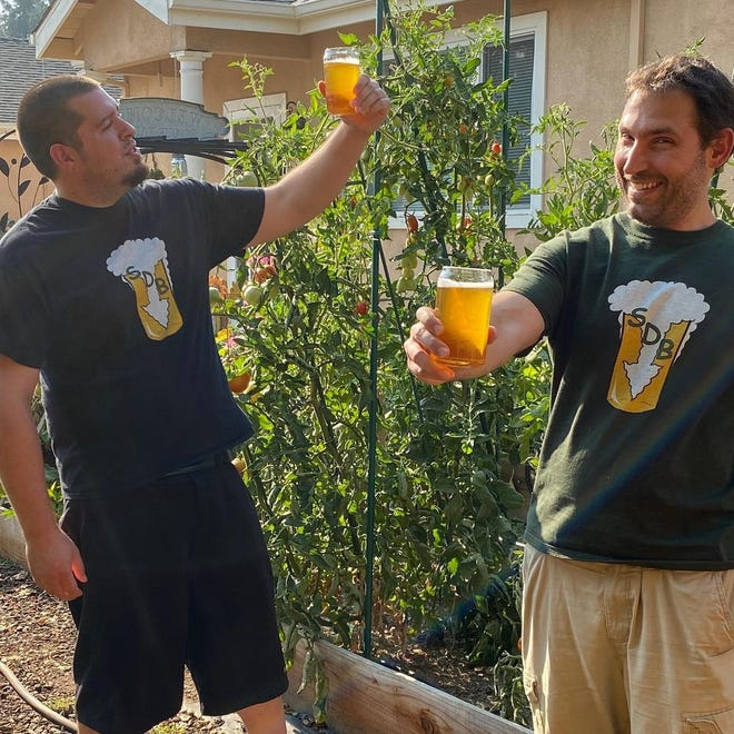Robert Anderson and Giovanni Albanese, brothers-in-law, are co-owners of the new brewery, Settle Down Beer.