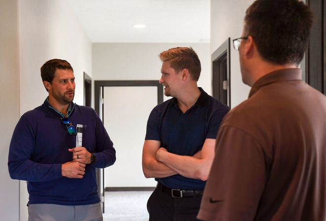 Reggie Kuipers and Alex Soundy give prospective tenant Kyle Korver a tour of an open office space on Wednesday, September 16, in southeastern Sioux Falls.
