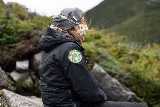 Kayla White, a summit steward coordinator for the Adirondack Mountain Club, sits at the summit of Wright Peak on Sunday, August 30, 2020.