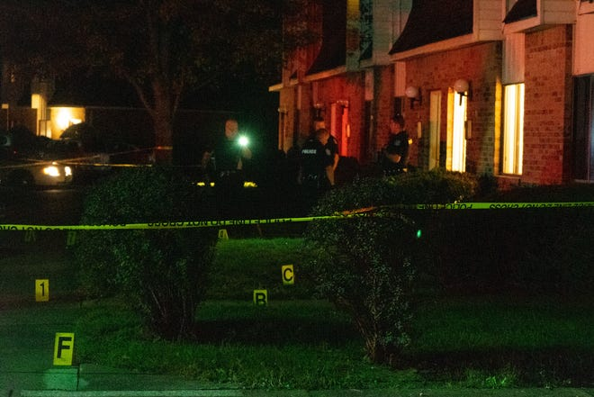 Officers from the Zanesville Police Department investigate a shooting at the intersection of Mapleview Drive and Athena Lane Tuesday night.