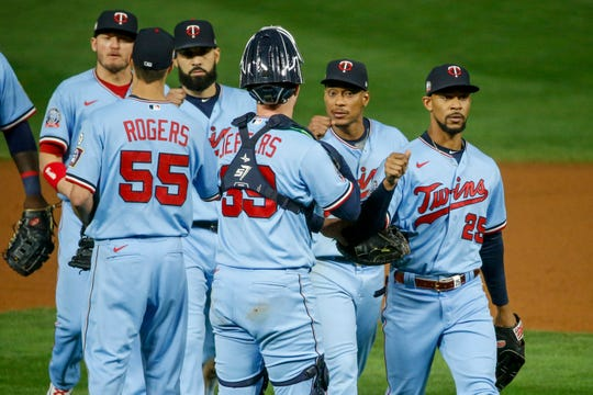 Twins players celebrate a win against the Indians.