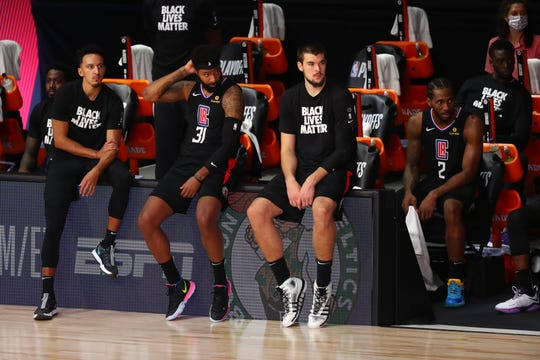 The  Los Angeles Clippers sit on the sidelines during the second half of their Game 7 loss to the Denver Nuggets.