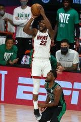 Jimmy Butler shoots in the second half of Game 1 against the Boston Celtics.