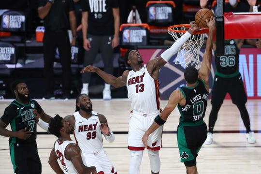 Miami Heat forward Bam Adebayo blocks Jayson Tatum's shot in overtime.