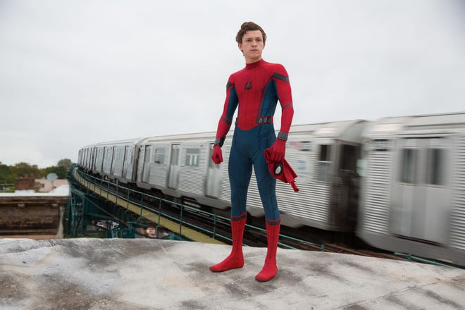 """Peter Parker (Tom Holland) juggles school life and his new superhero gig in """"Spider-Man: Homecoming."""""""