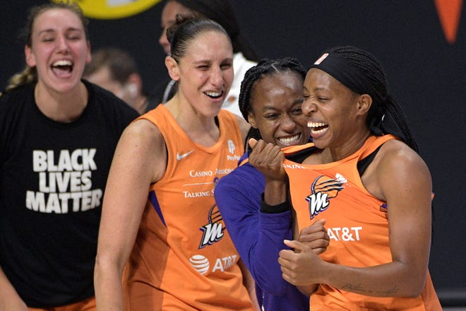 First round: Mercury guard Shey Peddy, right, is congratulated by teammates Shatori Walker-Kimbrough, second from right, Diana Taurasi and Alanna Smith, left, after Peddy hit a buzzer-beating three-pointer to lift Phoenix to a 85-84 win on Sept. 15, eliminating the Washington Mystics in the single-elimination game.