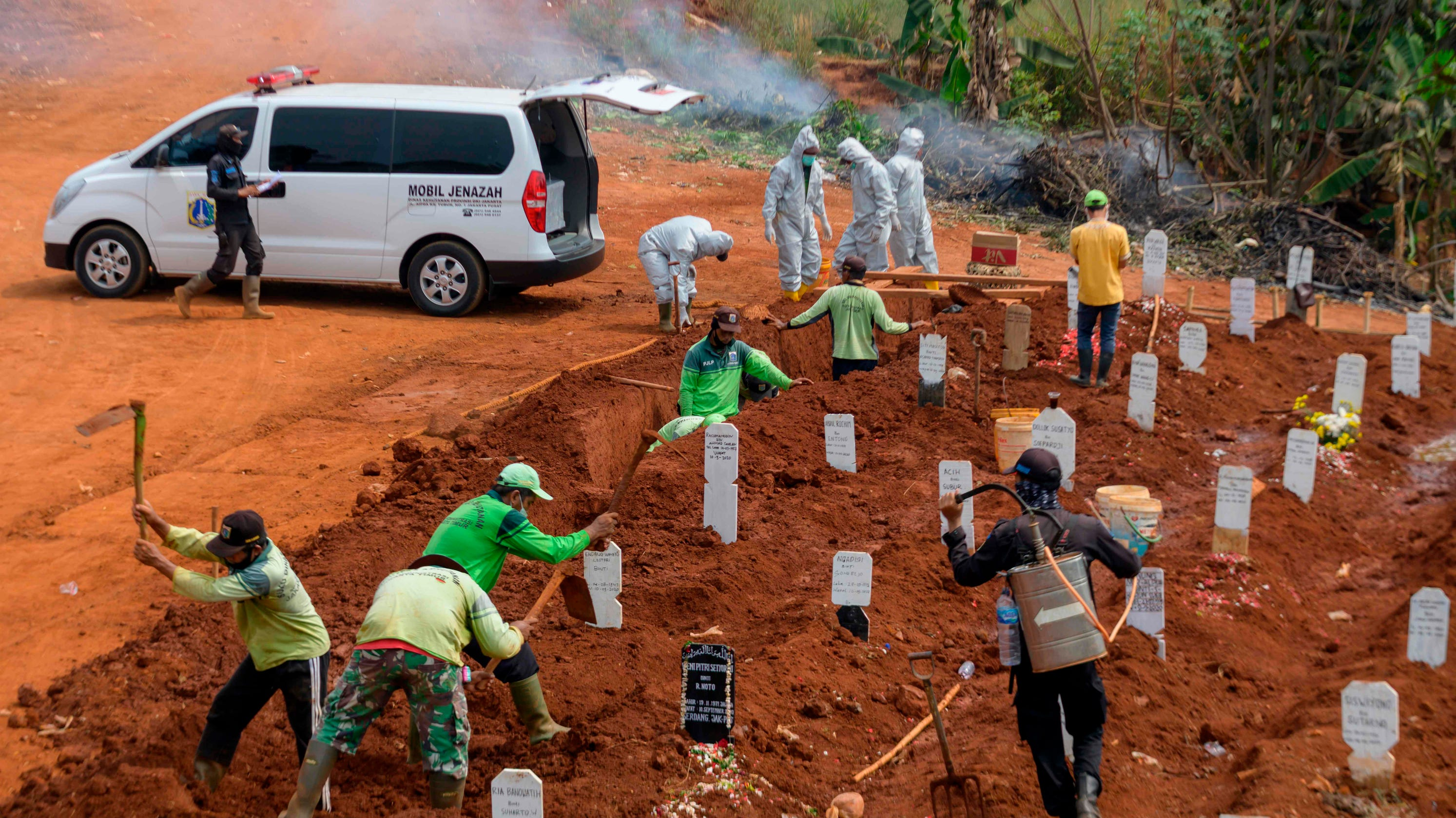 Eight people in Indonesia refused to wear face masks. They were ordered to dig graves for COVID-19 victims as punishment. – USA TODAY