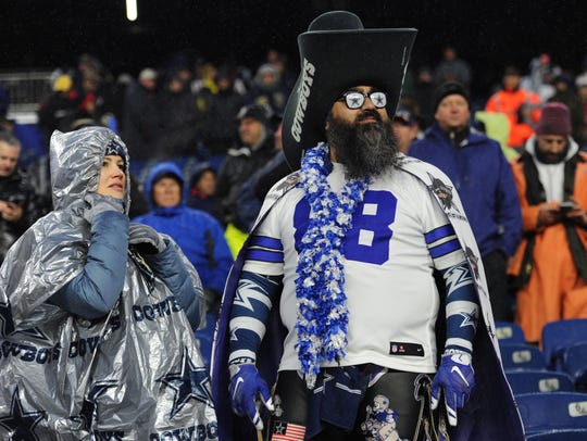 Dallas Cowboys fans get ready for the start of a game against the New England Patriots at Gillette Stadium.