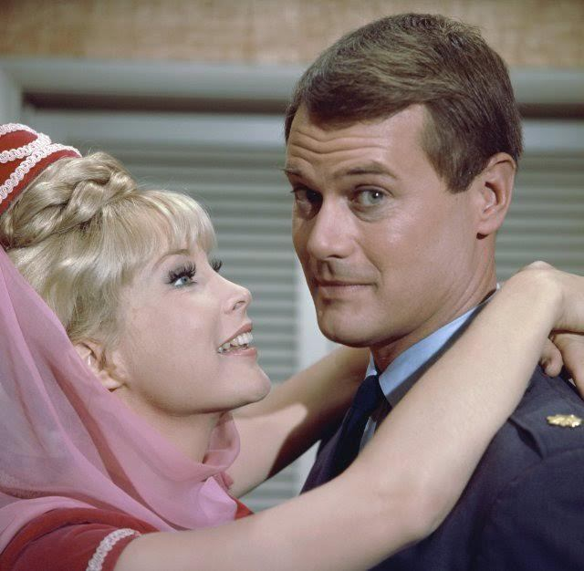 """Barbara Eden's Jeannie wraps her hands around Larry Hagman's Major Anthony Nelson, who freed her from her bottle in the 1960s sitcom, """"I Dream of Jeannie."""""""