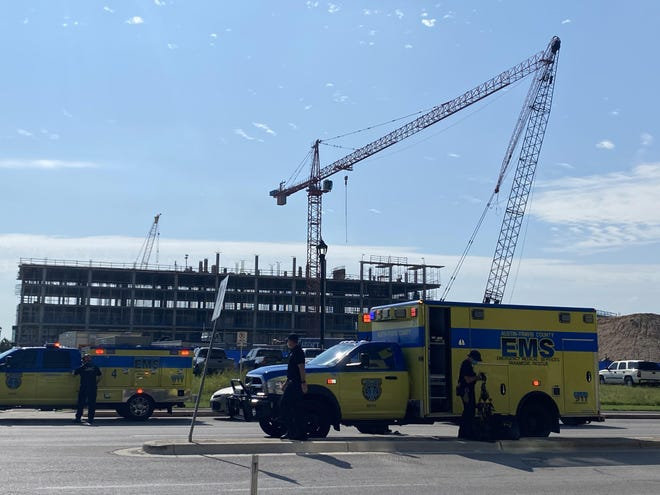 At least 22 people were injured after two cranes collided Wednesday morning in Austin, medics said.