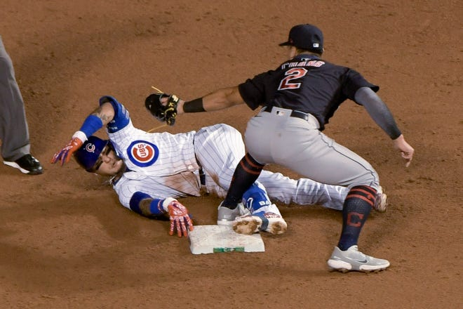 Indians second baseman Yu Chang tags out Chicago Cubs' Javier Baez during the second inning Wednesday in Chicago. Baez had singled, and tried to advance to second after the throw went to third. [Mark Black/The Associated Press]