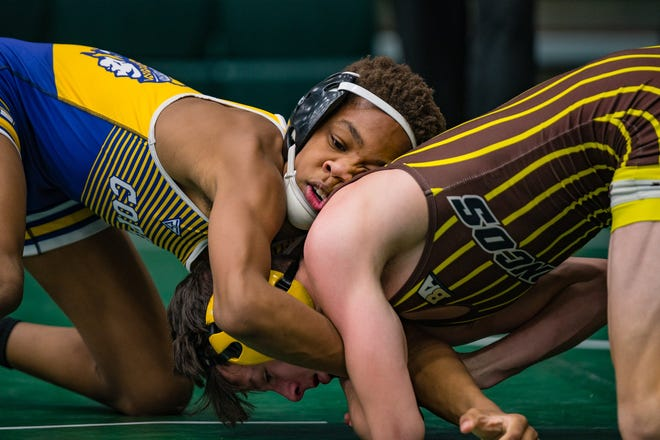 Copley's Marlon Yarbrough wrestles West Branch's Daniel Hunt during the semifinal round of the Medina Invitational Tournament on Dec. 28, 2019, at Medina High School. [Andrew Dolph/Akron Beacon Journal file photo]