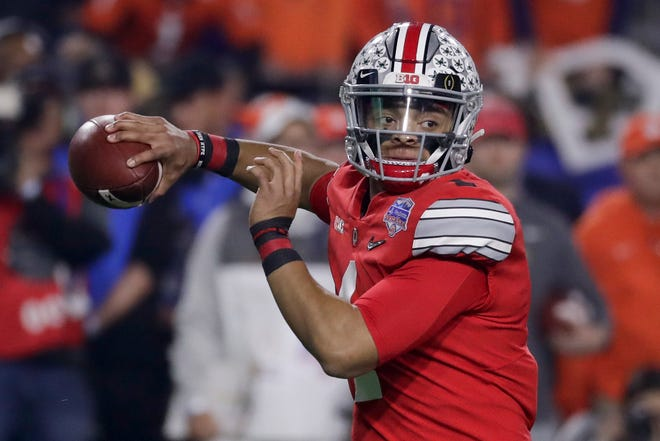 FILE - In this Dec. 28, 2019, file photo, Ohio State quarterback Justin Fields throws a pass against Clemson during the first half of the Fiesta Bowl NCAA college football playoff semifinal, in Glendale, Ariz. The Big Ten has approved a nine-game fall football season. (AP Photo/Rick Scuteri, File)