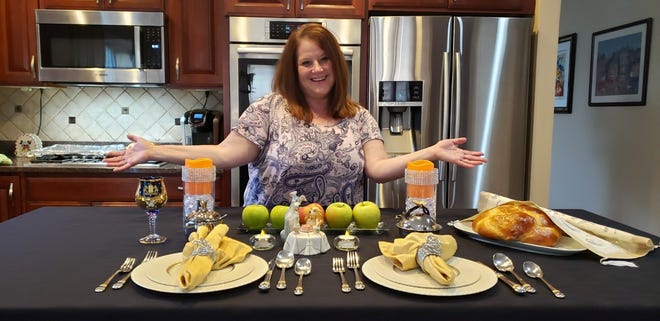 Phyllis Schachter of Lower Makefield shows the countertop she sets with challah bread and apples and honey to celebrate the holiday of Rosh Hashanah.  Schachter joined about 20 other women from the congregation for a Zoom meeting to discuss cooking and baking for the holiday.