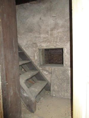 Subterranean stairs lead to vaults hidden by the Harmonists, who built Old Economy Village in Ambridge.