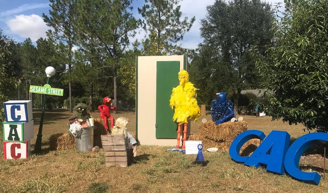 "Pictured is one of the scarecrow entries from last year, ""Sesame Street"" submitted by the Child Advocacy Center."