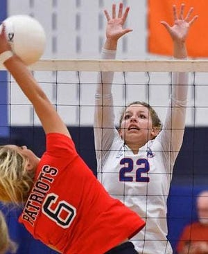 Providence Grove's Jill Stern (6) attempts a kill during a match in the 2019 season.