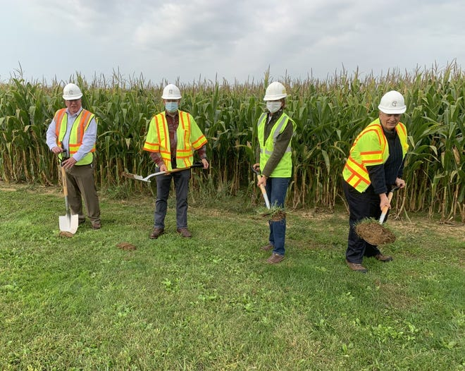Smithville Mayor Tom Poulson, village engineer Bob McNutt, Stacy Rogers of GE Baker Construction, and former Smithville Mayor Al Snyder break ground for a new $1.6 million water tank.