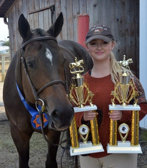 Ashley Yoder won the Senior Western Horsemanship Championship, Senior English Showmanship H/P 16 and older, Senior English Showmanship Championship, Senior Englsih Equitation H/P 16 and older and Senior English Equitation Championship in Junior Fair horse contests at the Wayne County Fair.