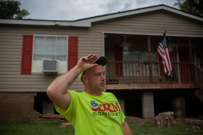Eddie Ceyrolles stands in front of his Sandy Hook, Tenn., home on Wednesday, Sept. 16, 2020. The brick foundation of the home was damaged after a flash flood swept through the community.