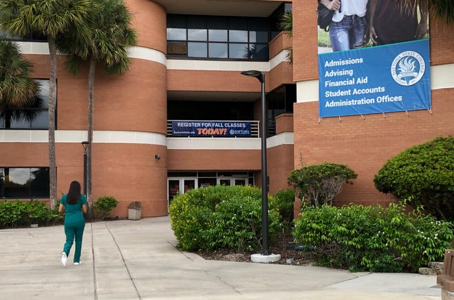 A student heads into the administration building at Daytona State College on Thursday, Sept. 17, 2020. The number of students enrolling this fall is down a bit from 2019, school officials say, but it has surpassed expectations given the pandemic.